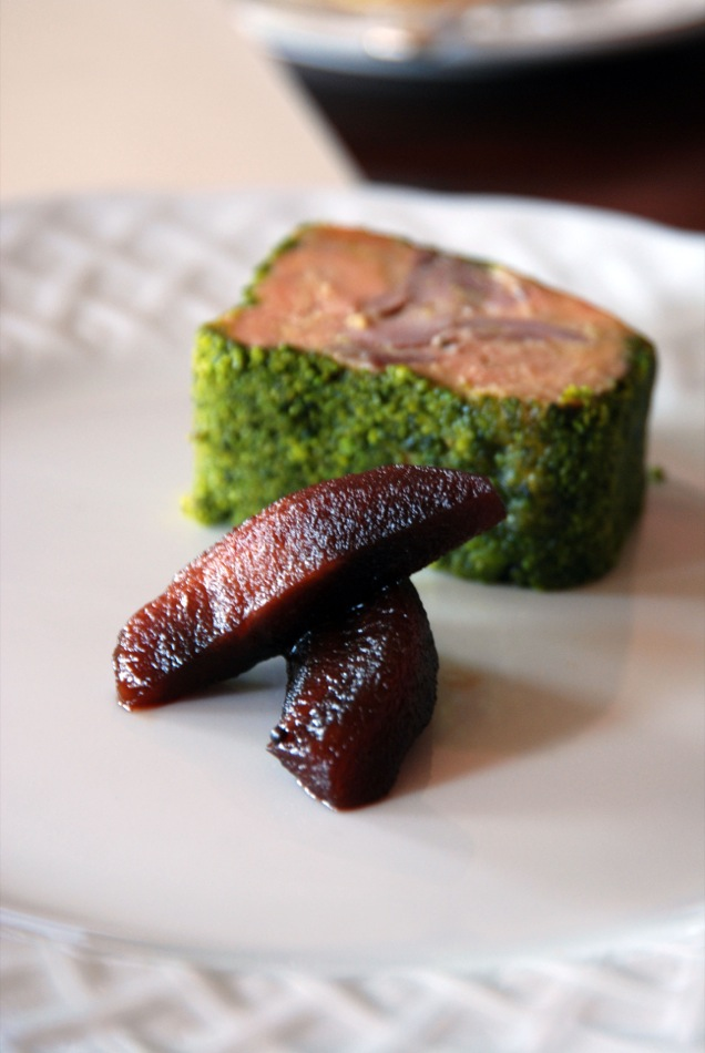 A press of Foie Gras and duck confit with pickeld apple and pistachio